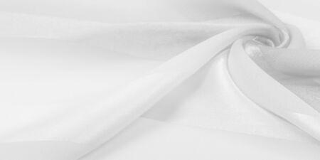 Texture, background, white silk striped fabric with a metallic sheen. Reklamní fotografie