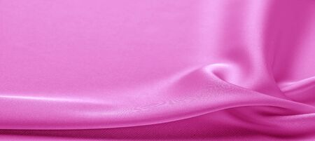 texture. Pink silk fabric. brilliant luster and characteristic small blinds that run horizontally throughout the fabric It falls into soft folds when draped and is the most versatile fabric we carry Foto de archivo - 130125913