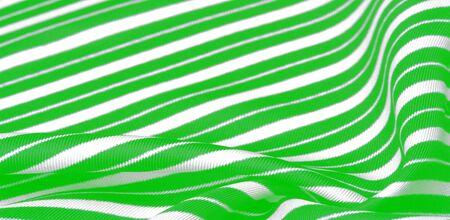 silk striped fabric. green white stripes.
