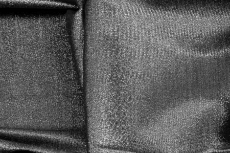 Texture, background, pattern. Cloth Gray black coated with a metallic silver thread. These fabrics are ideal for any project, wallpaper, all design solutions. and many uses of ships.