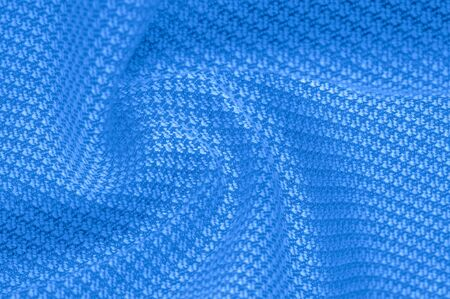 Background texture, pattern Fabric warm wool with stitched blue thread. Introducing our blue Wool Knitting this fabric will keep you in the cozy environment of your design a fantastic choice!