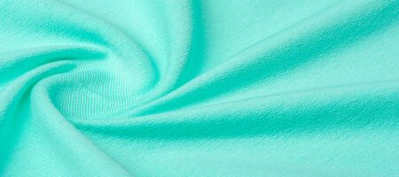 Texture, background, pattern. The fabric is knitted blue, turquoise, blue. I will add a creative approach to your next project. With this fabric, you will be the first, gentle color that you need