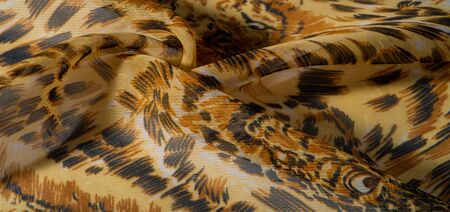 background pattern African fabric with silk print with tiger print.