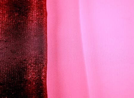 texture background pattern. Red silk fabric with a subtle matte sheen.