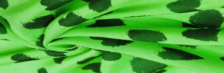 Texture, background, pattern, postcard, silk fabric, green print from the fabric of black hearts Imagens