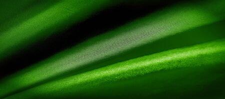 texture, background, pattern. green silk fabric panoramic photo.