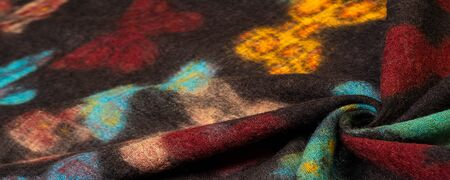 Texture, background, wool fabric in black with a colorful butterfly print, warmth 版權商用圖片