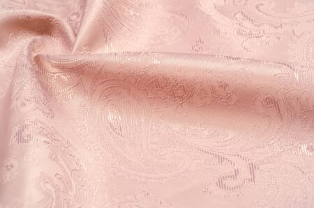 Texture, background, pattern. Fabric silk beige with a pattern of paisley. Archivio Fotografico