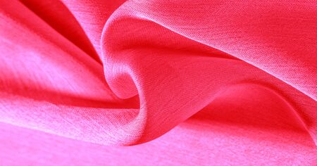 Background pattern texture wallpaper, crimson pink silk fabric. It has a smooth matte finish. Use this luxurious fabric for anything