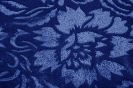 Texture background pattern velor cloth of blue color Velvet is synonymous with luxury One of the most characteristic qualities of velvet is its soft fuzzy heap Pile makes velvet smooth  rich in textur