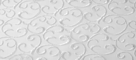 Texture pattern white This organza fabric is clean and light, and has magnificent ribbon embroidery This versatile fabric is ideal for creating stylish designs, wallpapers posters jewelry and accents Stock Photo