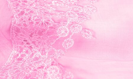 Texture, background, pattern, postcard, silk fabric, female amaranth pink scarf with lace wrappers. Use these fancy images to create your print and digital materials. Zdjęcie Seryjne