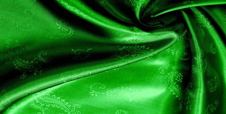 Texture, background, pattern Green silk chiffon fabric with a paisley print. This is a nice addition to any veneer. This is a beautiful floral design for your creativity.