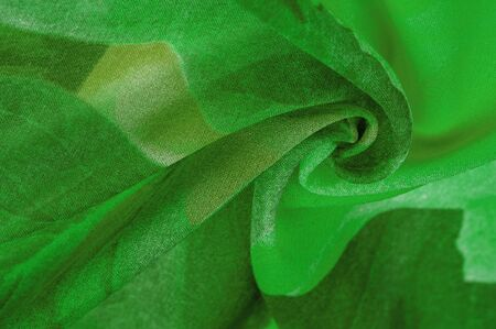 Texture, background, pattern, postcard, silk fabric, womens colored scarf with green white flowers. The gorgeous design is based on attractive background images. You will be the best