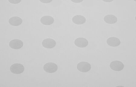 Textured background, black and white polka dot silk fabric. This versatile fabric is ideal for creating stylish design projects. Colors include gray and white.
