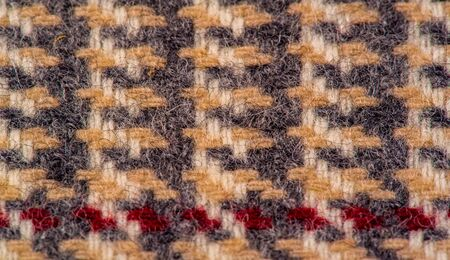 Background texture, pattern. The fabric is thick, warm in a cage, beige. This is 100% wool terry dressing. Sinil has a soft pile and is very versatile. It fits your design.