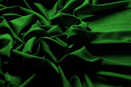 Textured, background, pattern, green fabric. Alpine upholstery Velvet hunter Green patio. This fabric - your decision in design, will give your page on the Internet a not forgetful foreshortening Reklamní fotografie