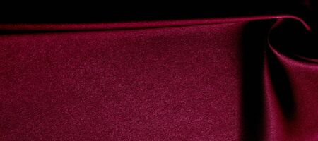 texture, red silk fabric panoramic photo. Silk Duke mood satin - beautiful and regal. It has a darker luster, then the usual satin on the one hand, has an average weight and has a more solid hand. Banco de Imagens