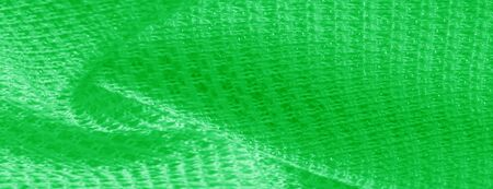 Background texture pattern Green fabric with metallic sequins This elegant and luxurious chic fabric is distinguished by sparkles of decorations. Ideal for special occasions overlay illusions designs