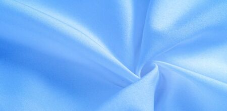 texture background, pattern.  silk blue fabric. From Telio, this organza has a thin, open weave that is thicker and sharper than silk gauze. Use this luxurious fabric for anything. The possibilities are really endless!