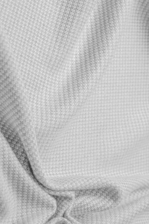 Background texture, pattern Fabric warm wool with stitched gray thread. Shake things with this white wool knit. Oversized, stocky knitwear is a modestly structured drape. Stockfoto