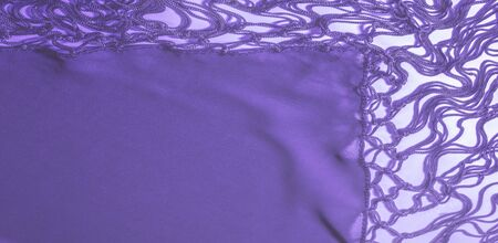 Background texture of silk fabric. This is a natural purple blue scarf, this beautiful nylon satin made of rayon with a transparent hand and a wonderful sheen is perfect for your projects.