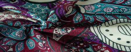 Background texture. cotton women scarf black and white pattern on one side of the scarf and color paisley pattern on the other side