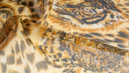 background pattern African fabric with silk print with tiger print. This amazing fabric will help you to plunge into the world of unbridled savannah. You will be sensual with design projects
