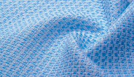Texture, fabric, pattern. Large weave of blue and white threads, tightly woven fabric with a very simple over-under weave and very little sheen, which makes it nice and professional.