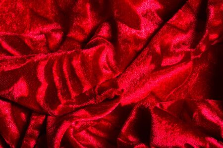 velor, cloth of red color. This gorgeous stretch velvet fabric has a velvety heap. Panne nap adds flicker and texture! It has a knitted back and is great for creating a stylish design