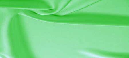 background texture, pattern. Green emerald silk fabric. This will add complexity to your design style. Its structural style characteristics are great for some of your decisions, wallpapers, posters.