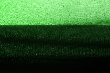 Textured, background, pattern, green fabric. Alpine upholstery Velvet hunter Green patio. This fabric - your decision in design, will give your page on the Internet a not forgetful foreshortening Stockfoto