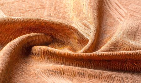 Picture. Texture, background. brown tapestry. From Santee Print Works, this cotton fabric is perfect for quilting accents, your design, décor. Colors include shades of tan and white. Stockfoto