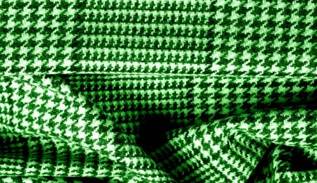 Background texture pattern. The fabric is thick, warm with a checkered pattern green This soft double damping with a light weight is ideal for design and more! Features yarn dyed checkered dark green