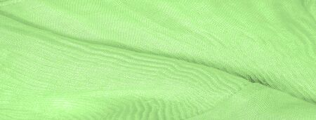 Texture, background, pattern, green silk corrugation crushed fabric for your projects Stockfoto - 131276237