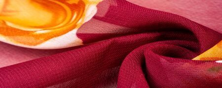 Texture, background, burgundy silk fabric with a pink floral print. Your projects are developed in our studio by designers who have deep knowledge in the use of their final product. Stockfoto - 131276240