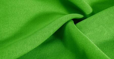 texture, background, pattern, green salad, silk fabric This very lightweight fabric made of artificial silk has a pleasant sheen. Ideal for adding elegance to your internet decor projects. Stockfoto - 131276244