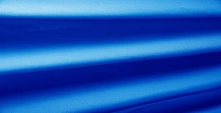 Picture. Texture, background. Blue sapphire silk fabric. This luxurious soft fabric has an ultra-soft and creamy surface with a diverse 10 mm pile of shades of gray. Stockfoto - 131276285