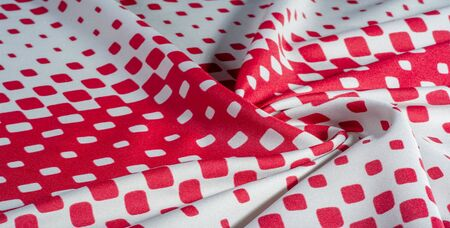 texture background pattern. silk fabric with a pattern of red squares on a white background. This is a heavy square 100% polyester pattern that fits perfectly with modern Stockfoto - 131276437