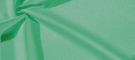 Texture, background, silk fabric, green womens shawl Convenient for your projects, the design of wallpaper cards Stockfoto