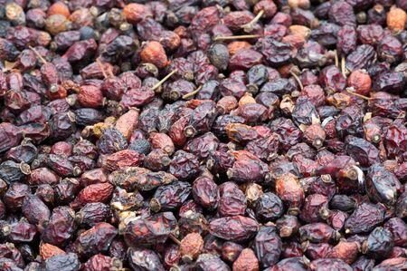 Texture background, pattern. Dried fruits. the sweet and fleshy product of a tree or other plant that contains seed and can be eaten as food. desiccated, exsiccated, roughage