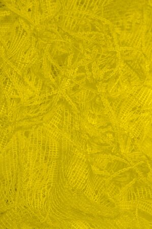 Texture, background, pattern. yellow tulle. With a simple design idea, create a couture look that refers to the softness of spring. In a collection of beautiful shades, how could you say no?