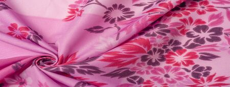 texture, background, pattern, delicate pink silk with floral print Exceptionally lightweight pure silk fabric with a delicate texture. Clean, use lining when opacity is desired. Reklamní fotografie