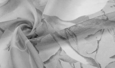 Texture, background, white silk with gray floral ornament. The fabric has a jacquard weave, thanks to which it received a lot of satin sections that gently twinkle Stockfoto