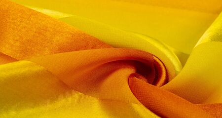 Texture, background, yellow silk striped fabric with a metallic sheen. If you have a bad mood, this fabric will lift it to unprecedented heights. Your project will be successful. Zdjęcie Seryjne