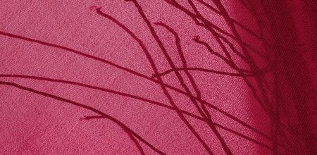 Background texture of silk fabric. This is a natural red scarf, this beautiful nylon satin made of artificial silk with a transparent hand and a wonderful sheen is perfect for your projects.