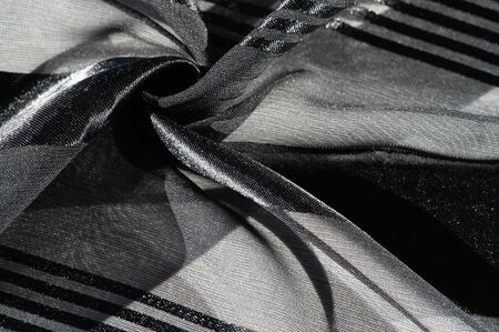 texture, background, pattern, collection, light transparent silk fabric with stripes of different size, black. exquisite luxury for your holiday! Zdjęcie Seryjne
