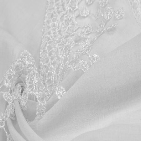 Texture, background, pattern, postcard, silk fabric, female white scarf with lace wrappers. Use these fancy images to create your print and digital materials. Reklamní fotografie