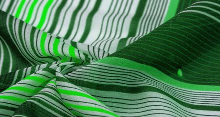 Texture, pattern, collection, silk fabric, green background with a striped pattern of white and salad lines, the Spanish theme, which is great for the design of procedures and projects. Zdjęcie Seryjne