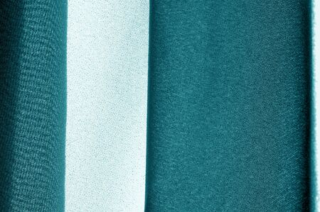 Textured, background, pattern, turquoise fabric. This is an unusual fabric that has an elegant appearance with a rich and coarse texture. It is tightly knit with designs built into the fabric itself Reklamní fotografie